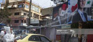 تعقيم لافتة لبشارالأسد في دمشق خلال حملة لتعقيم المدينة من فيروس كورونا كوفيد19 - 24 آذار 2020